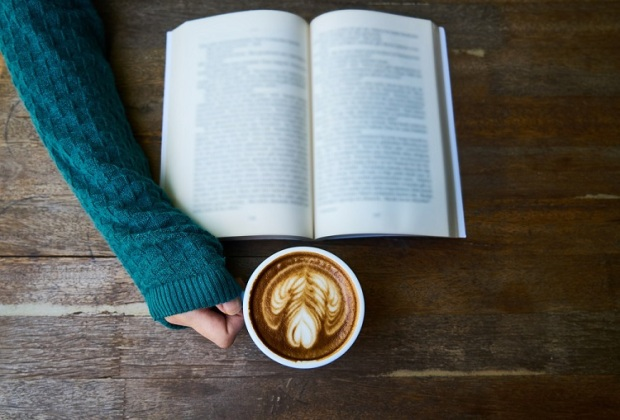 An open book with a coffee.